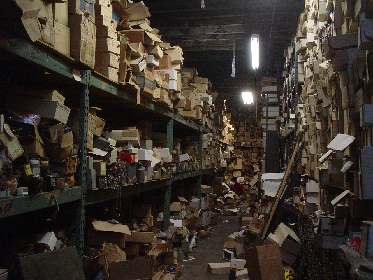 """Messy storage room with boxes"" by i ♥ happy!! from NY, NY - Flickr. Licensed under CC BY 2.0 via Wikimedia Commons - https://commons.wikimedia.org/wiki/File:Messy_storage_room_with_boxes.jpg#/media/File:Messy_storage_room_with_boxes.jpg"
